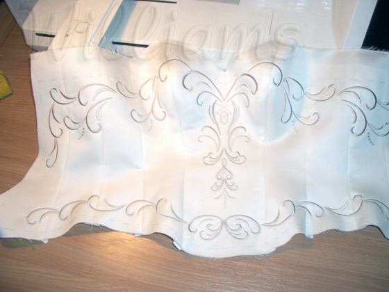 Embroidery on a wedding dress projects with machine